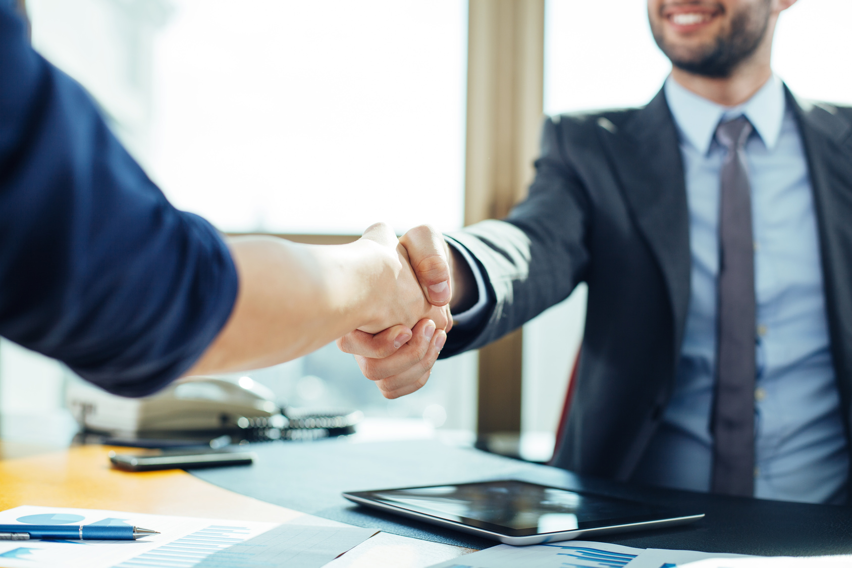 bartering services your business a skill to start learning close up of business handshake in the office